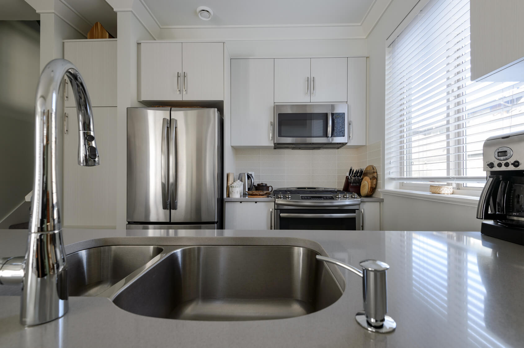 What comes first appliances or the kitchen design