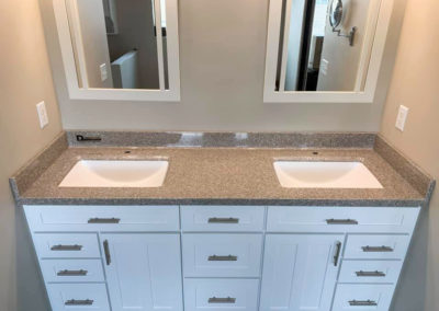 Double vanity sink with middle cabinet
